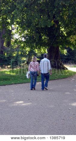 Couple Of People/Lovers Walking Hand In Hand