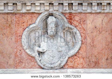 BOLOGNA, ITALY - JUNE 04: Saint Ambrose by Giovanni di Riguzzo relief on facade of the San Petronio Basilica in Bologna, Italy, on June 04, 2015
