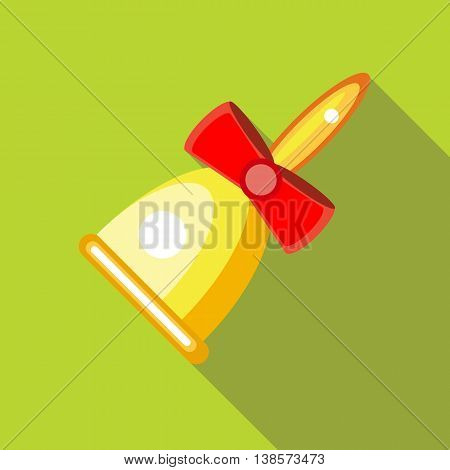 Gold bell with red bow icon in flat style on a green background