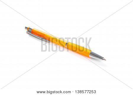 Orange ball-point  pen isolated on white background