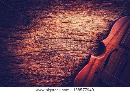 Violin on grunge dark old wood background