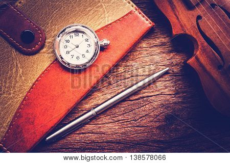 Blank Pocketbook with ink pen and old pocket watch