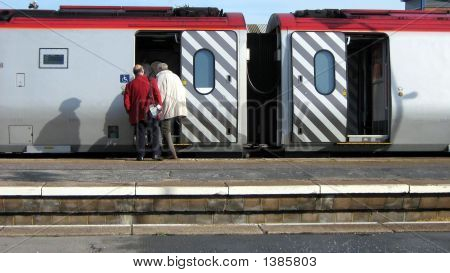 Ticket Collector/Guard & Passengers Entering A Train