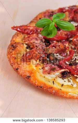 Italian flat bread with dry tomatoes and basil