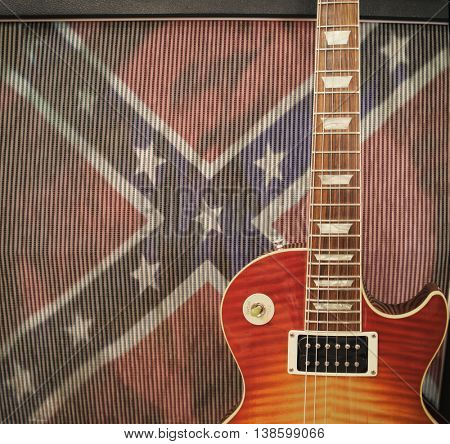 Southern Rock Concept - Guitar leaning up against amplifier with Confederate Rebel Flag - Vintage Instagram filter