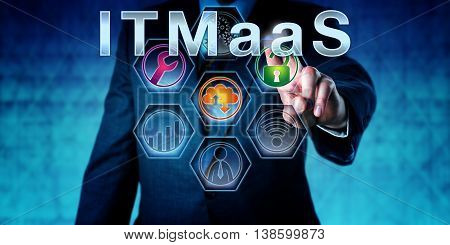 Enterprise executive is pressing ITMaaS on an interactive touch screen. Technology nomenclature and acronym for Information Technology Management as a Service. IT infrastructure concept. Close up.