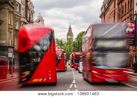 LONDON UK - 28TH JUNE 2016: A view along Whitehall Street in London during the day towards Big Ben and Elizabeth Tower. London Buses can be seen.