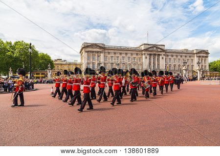 LONDON UK - 28TH JUNE 2016: Musical support from the Regimental Band during the Changing of the Guard ceremony at Buckingham Palace in the summer. The soldiers can be seen wearing scarlet tunics and bearskin caps