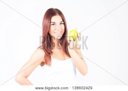 Happy smilling woman holding an apple. Healthy lifestyle.