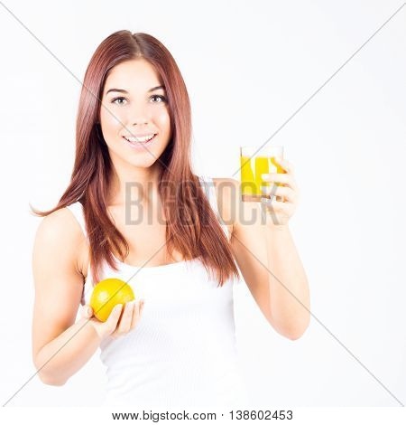 Happy smilling with teeth woman holding glass of orange juice and orange in hands. Healthy lifestyle.