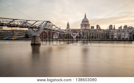St Pauls Cathedral and Millenium Bridge in the morning from across the River Thames
