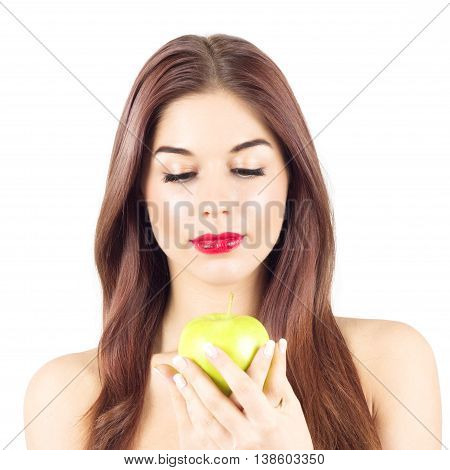 Portrait of beauty woman looking at green apple. Healthy diet and nutrition