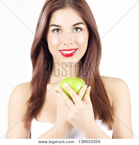 Portrait of beauty smiling woman holding green apple. Healthy diet and nutrition. Smile with white teeth.