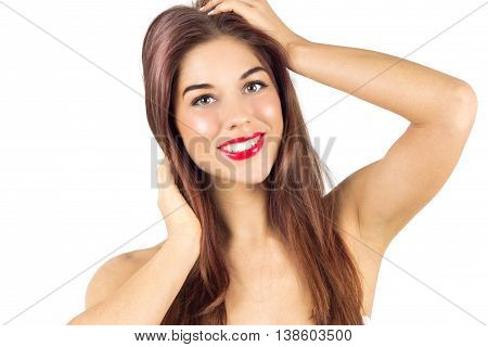 Tanned woman smiling with teeth. Woman with red lips. Woman after tanning