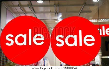 Sale Signs On The Window Of A Store