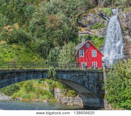 Steinsdalsfossen (also called Øvsthusfossen or Øfsthusfossen) is a waterfall in the village of Steine in the municipality of Kvam in Hordaland county Norway. Steinsdalsfossen is 46 metres (151 ft) high with a main drop of 20 metres (66 ft)