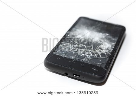 Smartphone with a shattered screen. Dropped phone insurance claim