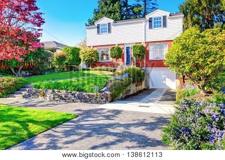 Beautiful Curb Appeal Of Two Level House With One Garage Space.