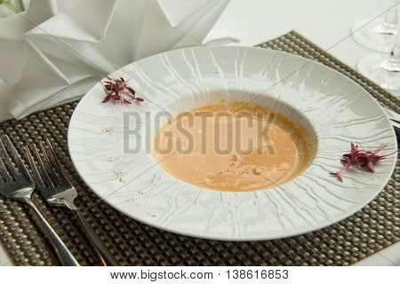 Homemade Lobster Bisque Soup with Cream in white dish