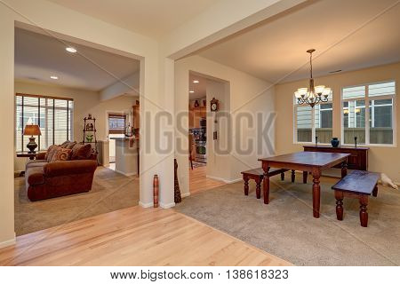 Open Floor Plan. View Of Dining Room With Carved Wooden Table, Living Room And Kitchen
