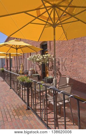 Row of yellow umbrellas in an outdoor caffe Walla Walla WA.