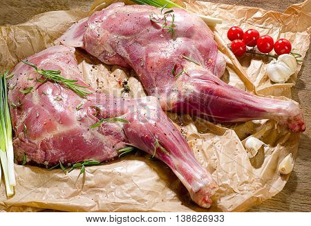 Raw Lamb Shanks Ready For Frying On A Wooden Board.