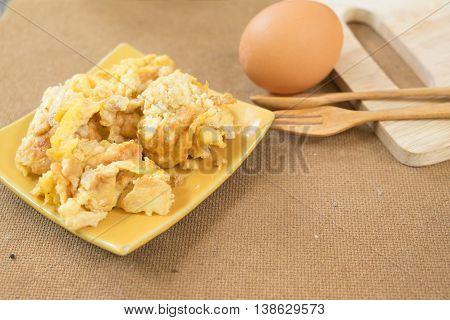 Fries egg in plate Thai omelet style