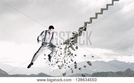Man breaking ladder . Mixed media