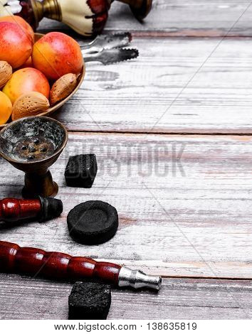 Details Eastern smoking hookah with fruit apricot
