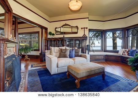 Vintage Style Living Room With Fireplace And Antique Wooden Cabinet.