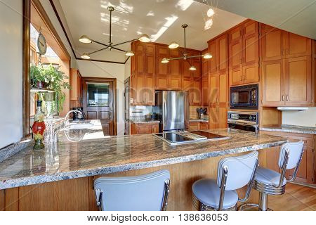 Great Kitchen Room With High Ceiling And Modern Cabinets.