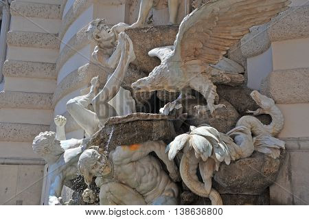 VIENNA AUSTRIA - JUNE 6 2016: The Power on Land fountain by Edmund Hellmer in the Hofburg Castle Vienna of June 6 2016.