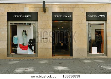 VIENNA AUSTRIA - JUNE 6 2016: Facade of Giorgio Armani flagship store in the street of Vienna of June 6 2016. Giorgio Armani is a world famous french luxury company founded in 1975.