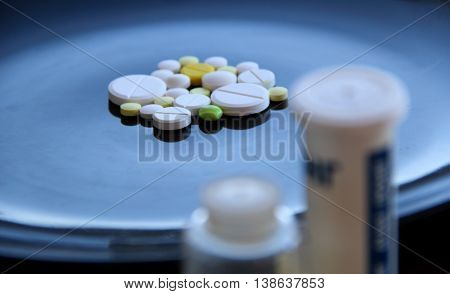 Medicinal pills and tablet containers with differential focus studio isolated
