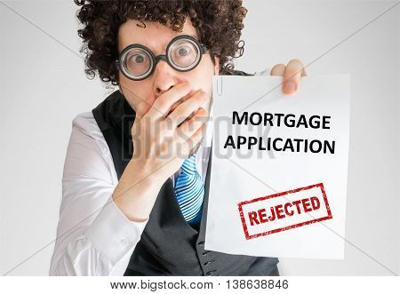 Disappointed Businessman Is Showing Paper With Denied Loan Appli
