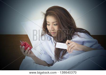 Beautiful Woman Lying On Bed Sleepless At Night.