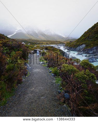 A hiker tramping on Hooker Valley track during raining.