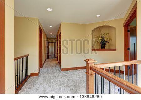 Upstairs Empty Hallway Interior With Carpet Floor.
