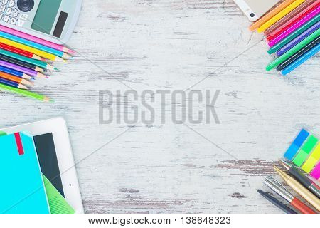 back to school frame with school supplies on wooden table