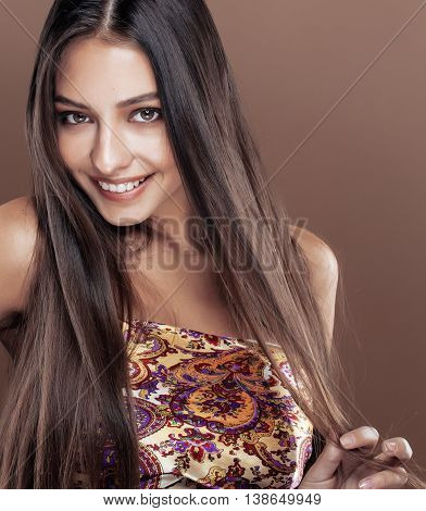 cute happy young indian real woman in studio close up smiling, fashion mulatto adorable