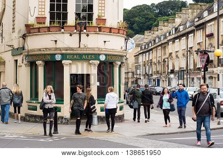 BATH SOMERSET UK - JULY 15 2016 Hobgoblin Public House with people. Pub on St. James's Parade in the UNESCO World Heritage City of Bath in Somerset England