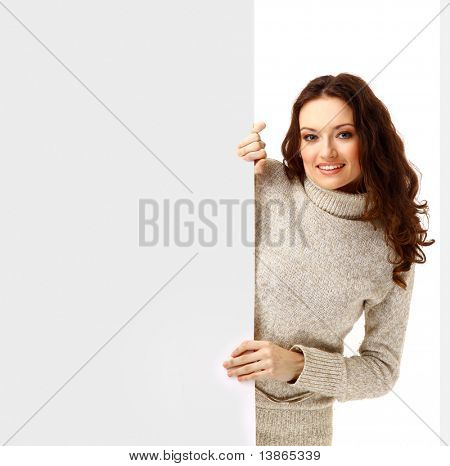 Surpriced woman holding sign - Portrait of a beautiful woman holding a blank billboard.