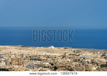 Background center shows San Dimitri chapel with in the foreground the village of Gharb