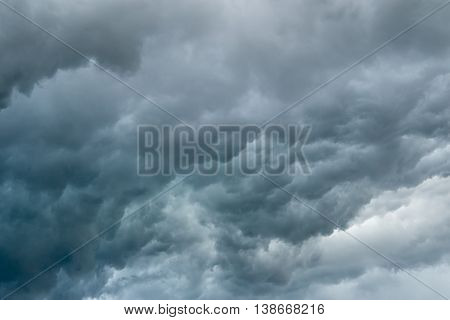 Dark stormy blue clouds about to rain. Envornment and disaster concept.