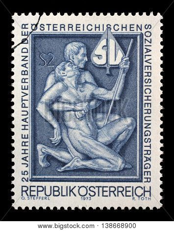 ZAGREB, CROATIA - JULY 03: stamp printed by Austria, shows Symbolism for aid and support, 25th Anniversary of the Austrian Social Security Carrier circa 1973, on July 03, 2014, Zagreb, Croatia
