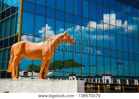 The Horse Memorial In The Background Of The Glass Mirrored Building. Moscow. Russia.