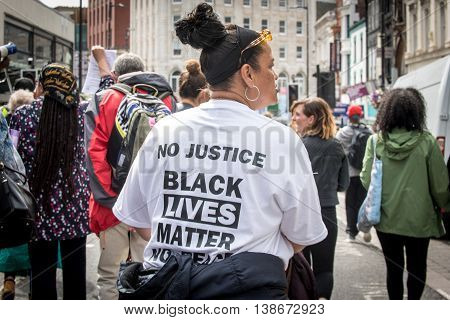 Liverpool Uk - July 16th 2016: A woman wears a t-shirt with the message No Justice Black Lives Matter at a march in Liverpool in solidarity to the Black Lives Matter movement in America