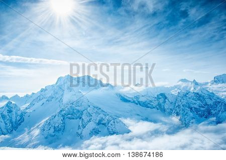 beautiful winter landscape of Dombaj mountains higher than clouds close up top veiw