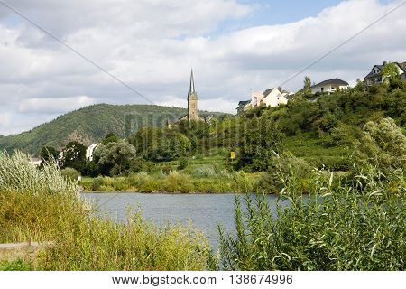 A scenic landscape with the Mosel river near Kobern-Gondorf in Germany. Kobern-Gondorf is a municipality in Rhineland-Palatinate on the Mosel river.