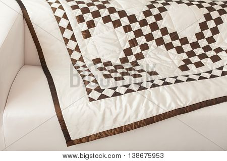 Patchwork quilt. Part of patchwork quilt as background. A blanket in style patchwork. Color blanket. Handmade. Blanket with geometrical print.